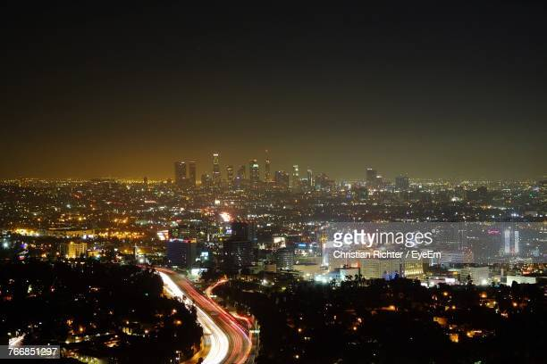 "illuminated cityscape against sky at night - ""christian richter"" stock pictures, royalty-free photos & images"