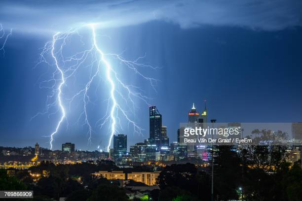 illuminated cityscape against sky at night - perth australia stock pictures, royalty-free photos & images
