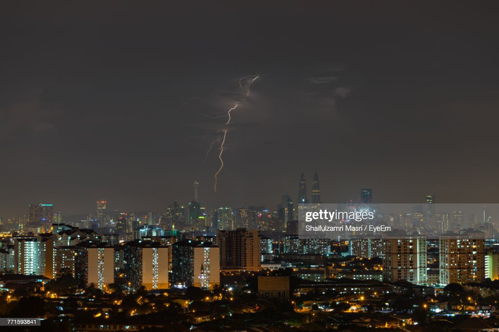 Illuminated Cityscape Against Sky At Night : Stock Photo