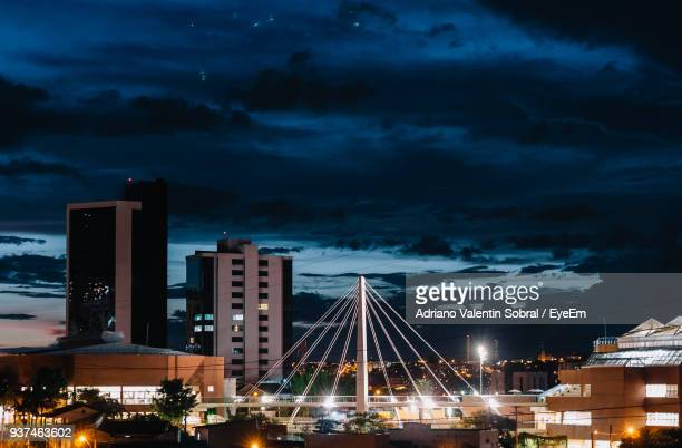 illuminated cityscape against sky at night - sorocaba stock pictures, royalty-free photos & images