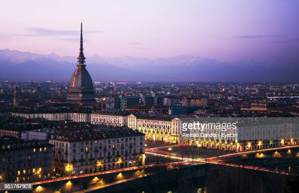 illuminated cityscape against sky at night - turin stock pictures, royalty-free photos & images