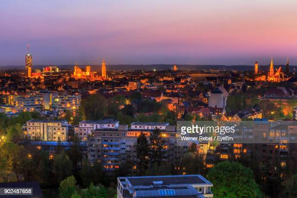 illuminated cityscape against sky at sunset - augsburg stock pictures, royalty-free photos & images