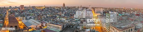 illuminated cityscape against sky during sunset - capitali internazionali foto e immagini stock