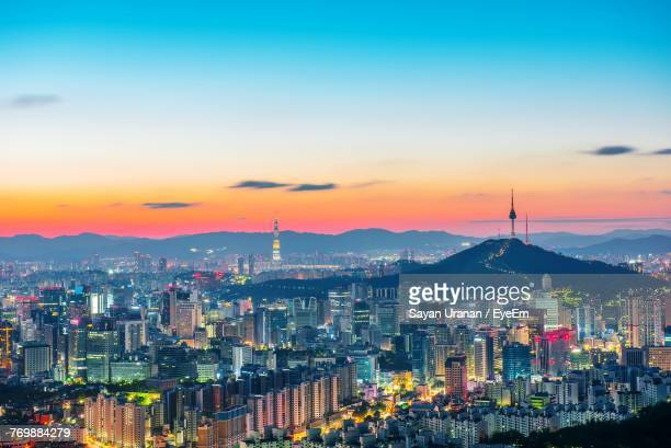 illuminated cityscape against sky during sunset - seoul stock pictures, royalty-free photos & images