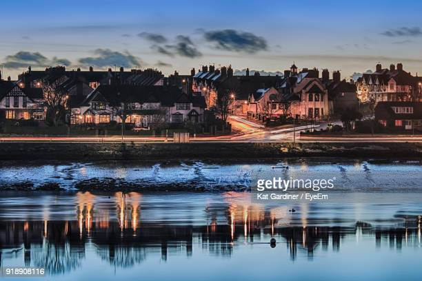 illuminated cityscape against sky - barrow in furness stock photos and pictures
