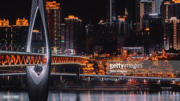 Illuminated cityscape and bridge at night