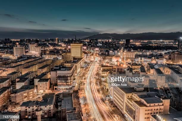 illuminated cityscape and city street at night, hohhot, inner mongolia, china - hohhot fotografías e imágenes de stock