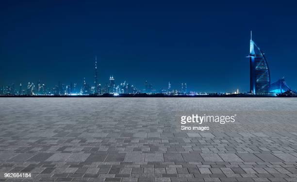 illuminated cityscape at night, dubai - image stock pictures, royalty-free photos & images