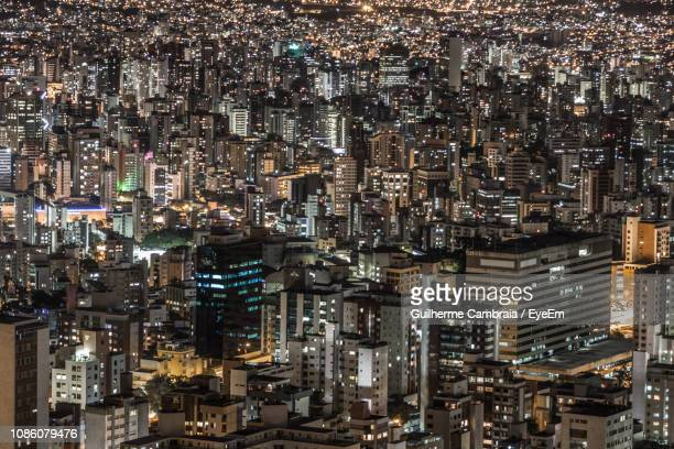 illuminated cityscape at night - belo horizonte stock pictures, royalty-free photos & images