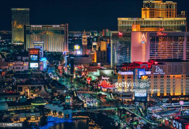 illuminated cityscape at night - las vegas stock pictures, royalty-free photos & images