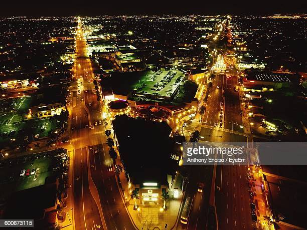 illuminated cityscape at night - costa mesa stock photos and pictures