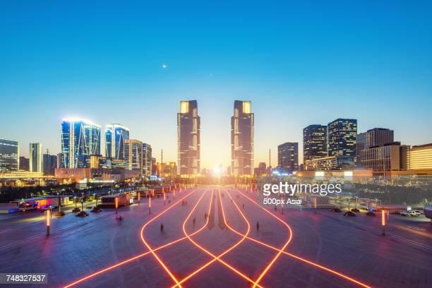 illuminated cityscape at night, zhengzhou, henan, china - zhengzhou stock pictures, royalty-free photos & images