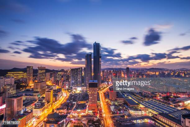 Illuminated cityscape at sunset, Dalian, China