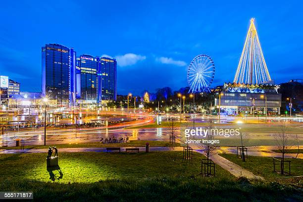Illuminated cityscape with Ferris wheel
