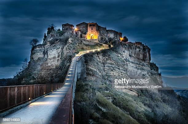 illuminated civita di bagnoregio against sky at night - civita di bagnoregio foto e immagini stock