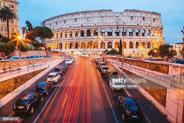 illuminated coliseum at dusk, rome, italy - coliseum rome stock photos and pictures