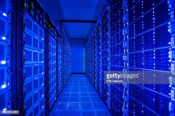 illuminated computer equipment in server room - data center stock pictures, royalty-free photos & images