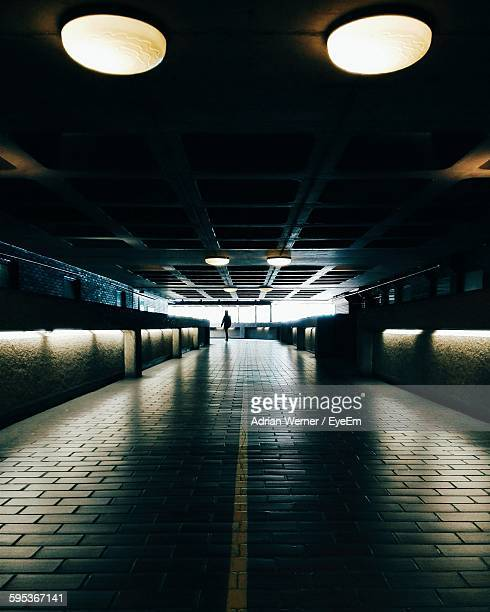 illuminated corridor at barbican centre - barbican centre london stock pictures, royalty-free photos & images