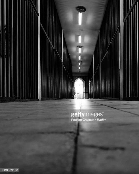illuminated corridor in prison - tehran stock pictures, royalty-free photos & images