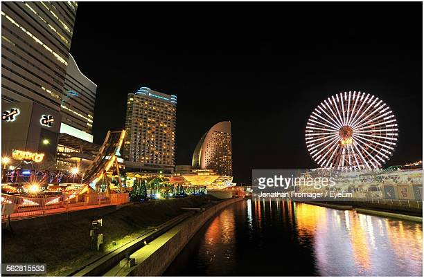 Illuminated Cosmo Clock 21 With Modern Office Buildings At Night In Minato Mirai