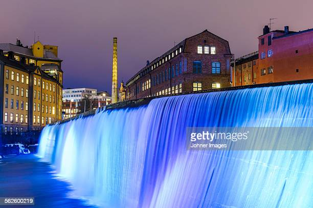 illuminated cotton mill waterfall - norrkoping fotografías e imágenes de stock
