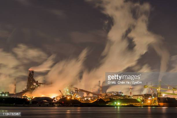 illuminated cranes against sky at night - aichi prefecture stock pictures, royalty-free photos & images