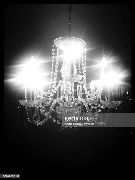 Illuminated Crystal Chandelier Hanging On Ceiling