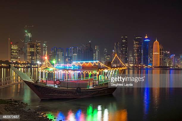 Illuminated dhow and Doha skyline