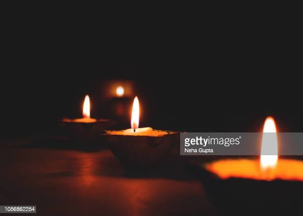 illuminated diya - religious christmas stock photos and pictures