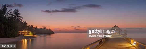 Illuminated dock at dusk
