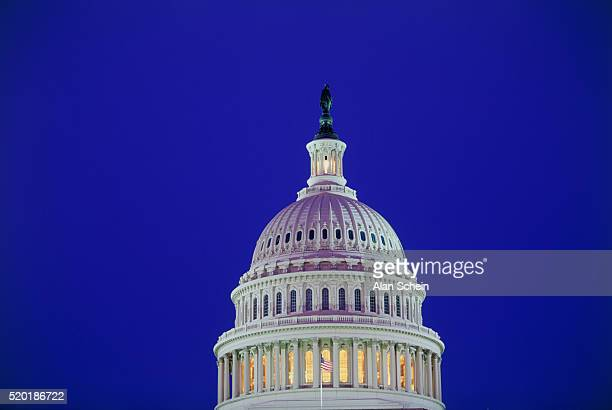 illuminated dome of the u.s. capitol building - united states capitol rotunda stock pictures, royalty-free photos & images