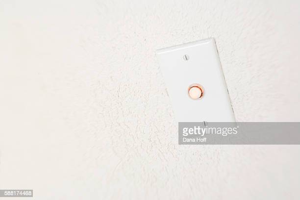 illuminated doorbell on white stucco wall - dana white stock pictures, royalty-free photos & images