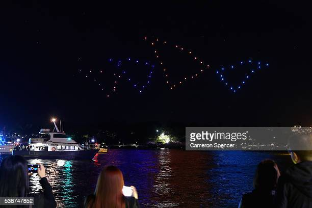 100 illuminated drones perform a choreographed routine over Sydney Harbour accompanied by Beethovens Fifth Symphony performed by Sydney Youth...