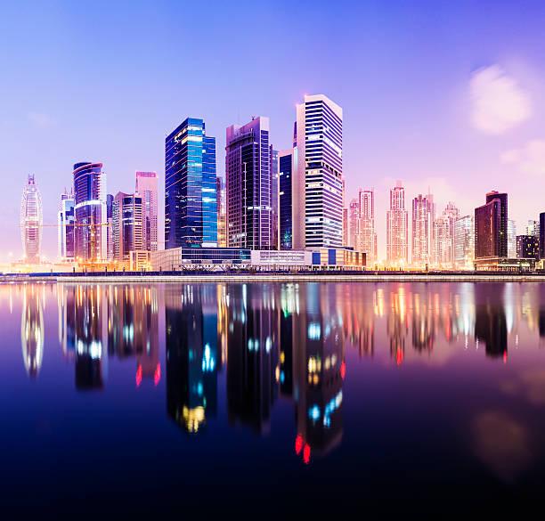 Illuminated Dubai City Skyline At Sunset, United Arab Emirates. Wall Art