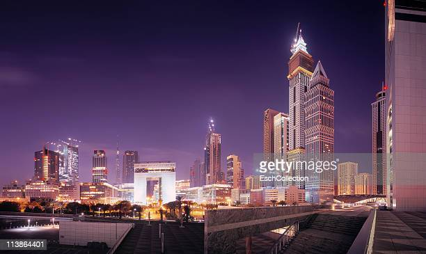 Illuminated Dubai skyline with Financial Centre