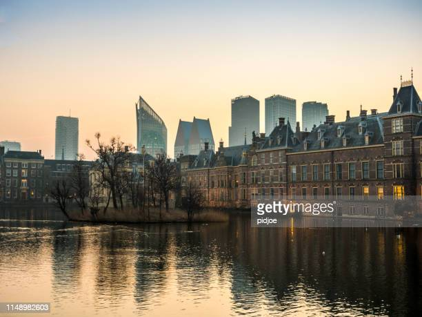 illuminated dutch parliament buildings in the hague, early morning. the netherlands - the hague stock photos and pictures