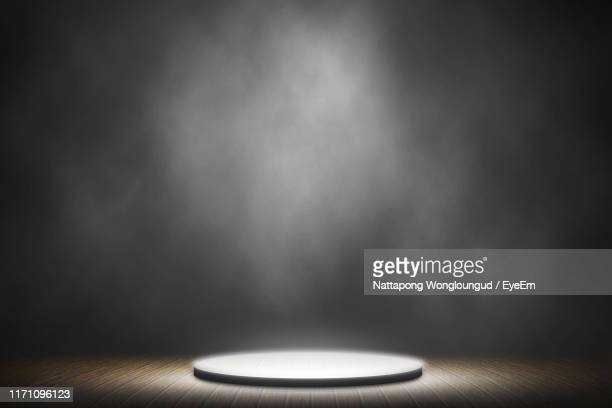 illuminated electric lamp on table - spotlit stock pictures, royalty-free photos & images