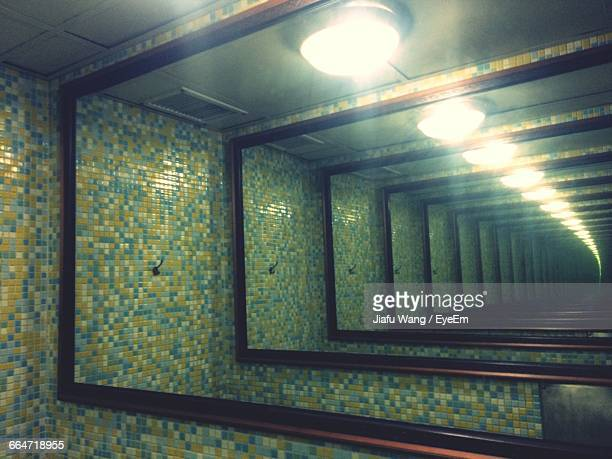 illuminated electric lights in mirror - vanishing point stock pictures, royalty-free photos & images
