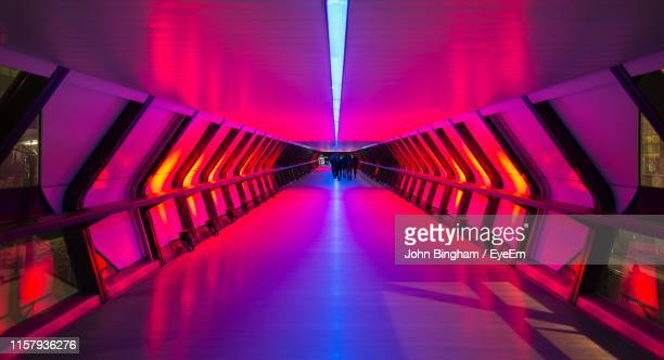 illuminated empty corridor - tunnel stock pictures, royalty-free photos & images