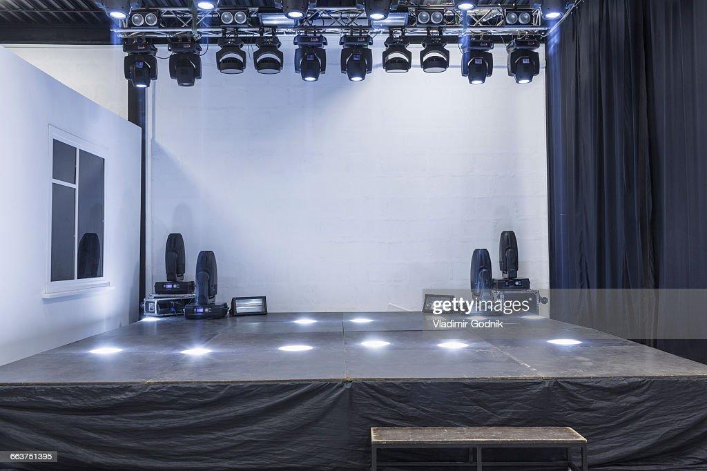 Illuminated empty stage in studio : Stock Photo