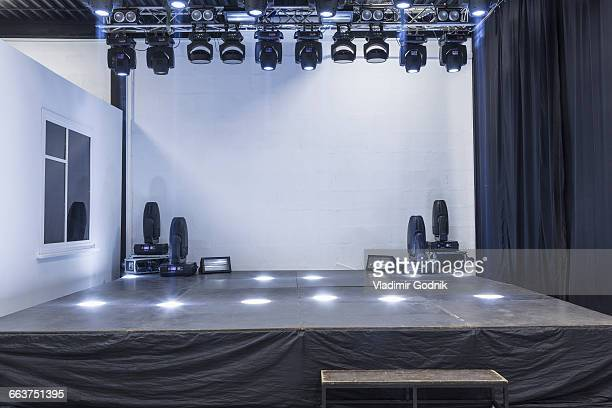 Illuminated empty stage in studio
