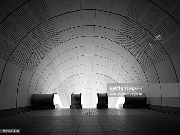 illuminated entrance of underground railroad station - arch architectural feature stock pictures, royalty-free photos & images