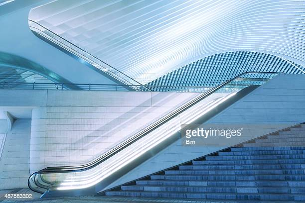 illuminated escalator outside futuristic train station illuminated at night - curve stock pictures, royalty-free photos & images