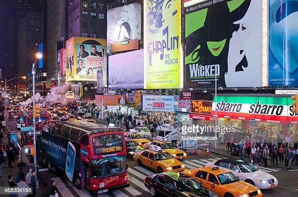 illuminated facades of broadway theaters in times square, nyc, usa - us state border stock photos and pictures