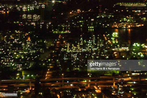 Illuminated factory area in Kawasaki city in Kanagawa prefecture in Japan night time aerial view from airplane