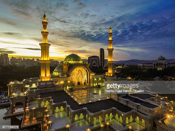 Illuminated Federal Territory Mosque Against Sky During Sunset