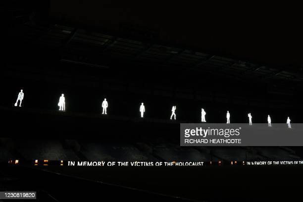 Illuminated figures representing victims of the Holocaust are displayed for 'Holocaust Memorial Day 2021' at the English Premier League football...