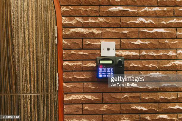 Illuminated Fingerprint Scanner On Wall