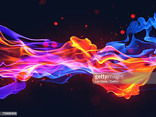 Illuminated Fire Against Black Background