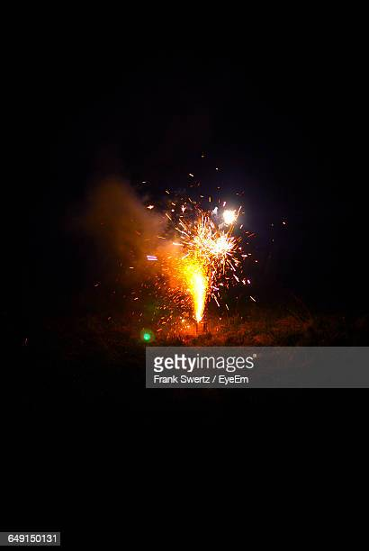 illuminated firework on field at night - frank swertz stock pictures, royalty-free photos & images